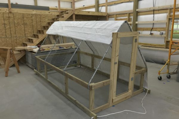 A chicken tractor under construction in the SLAP Farms shop